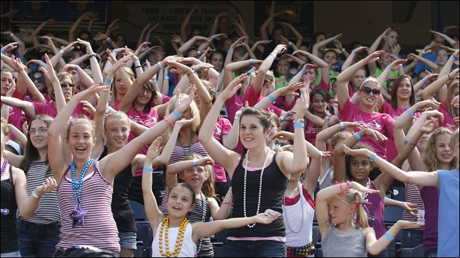 YMCA Gymnasts from around the country sing 'YMCA'  at Fifth Third Field Wednesday, June 22.