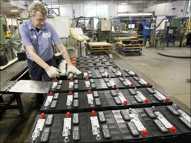 Johnson Controls to double local plant Bob Ritter stacks batteries for shipping at the Johnson Controls plant on Industrial Road near Toledo Express Airport. The company plans to convert production to batteries with new technology.