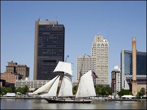 The Lynx sails down the Maumee River with downtown Toledo in the background.