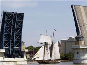 The Lynx sails under the MLK Bridge into Toledo on Thursday to be part of the weekend's Red White Kaboom festivities.