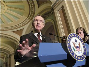 Senate Majority Leader Harry Reid (R., Nev.,) speaks to reporters following the Democrats' weekly policy luncheon this week on Capitol Hill in Washington.