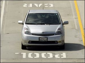 Hybrids such as this Toyota Prius on I-405 in Los Angeles will have to return to using  regular traffic lanes.