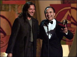 "Tomatito, left, and Michel Camilo accept the award for best Latin jazz album for ""Spain"" in this 2000 file photo."