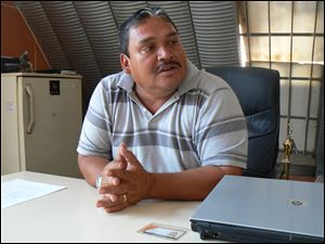Rigoberto Carias, operations manager of the Guatemala City dump, says landfill officials have improved safety and health conditions for workers and have made progress on preventing avalanches and fires among the trash piles.