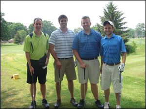 D.O.V.E. Fund trustee Doug Welch and friends enjoy the organization's annual golf outing at South Toledo Golf Club.