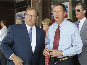 Gary Heminger, left, Marathon Petroleum Corp.'s chief executive, and Ohio Gov. John Kasich tout the Findlay company's new independence and expansion as a benefit for northwest Ohio.