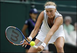 Petra Kvitova of the Czech Republic returns a shot to Victoria Azarenka. She is the first left-handed woman in a major final since 1998.