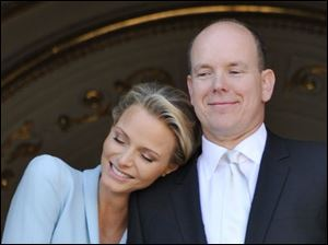 Prince Albert II of Monaco appears with his bride, Charlene, Princess of Monaco, at the Monaco palace, after the civil wedding marriage ceremony Friday.