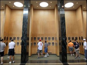 Patrons of the Baseball Hall of Fame and Museum view the plaques of inducted members during induction weekend July, 2010.
