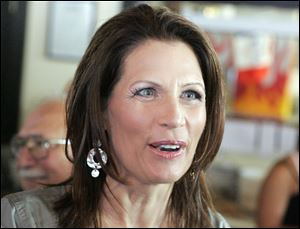Republican presidential candidate Michele Bachmann speaks with a supporter during a breakfast chat earlier this week