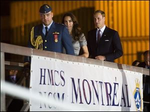 The Duke and Duchess of Cambridge arrive on board the HMCS Montreal  in Montreal Saturday to depart for Quebec City.