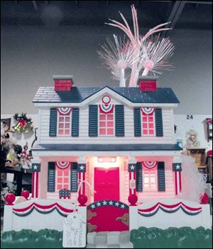 This model house features patriotic bunting and fireworks.