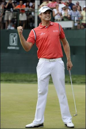 Nick Watney pumps his fist after winning the AT&T National golf tournament at Aronimink Golf Club.