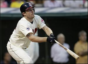 Cleveland Indians' Austin Kearns watches his three-run home run off A.J. Burnett.