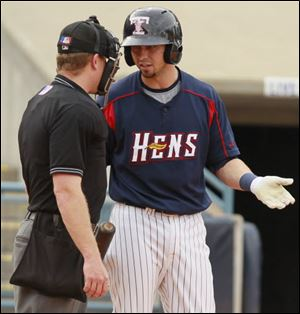 The Hens' Cale Iorg argues a called strike with home plate umpire Toby Basner.