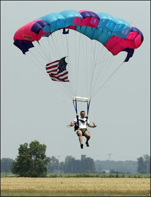 Rod Collin of Sky Dive Tecumseh performs in a parachute demonstration.