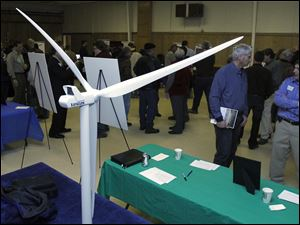 A wind turbine is modeled during Blissfield Wind Energy project team open house at the Blissfield American Legion in Michigan in March.