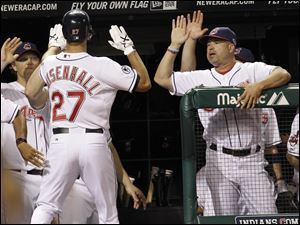 Cleveland Indians' Lonnie Chisenhall, left, is congratulated by manager Manny Acta after Chisenhall hit a solo home run off Yankees relief pitcher Boone Logan in the seventh.