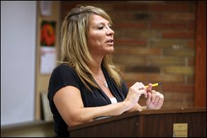 Joni Meyer-Crothers, who was featured on the TLC cable show 'Extreme Couponing,' shares tips during a seminar at Wood County Public Library.