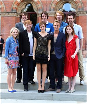 Back, from left, Oliver Phelps, James Phelps, Domhnall Gleeson, Matthew Lewis, and front, from left, Evanna Lynch, Rupert Grint, Emma Watson, Tom Felton, Bonnie Wright attend a photocall for 'Harry Potter and the Deathly Hallows: Part 2' at The Renaissance St Pancras Hotel.