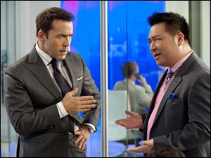 Ari Gold (Jeremy Piven), left, and his ex-assistant Lloyd (Rex Lee) are agents on HBO's 'Entourage.'