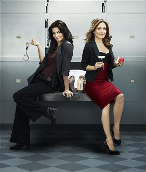 Angie Harmon, left, and Sasha Alexander are the title characters in 'Rizzoli & Isles,' which starts its second season Monday on TNT.