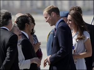 Prince William and Kate, the Duke and Duchess of Cambridge, are greeted by British Consul-General Dame Barbara Hay, second left, as they arrive at Los Angeles International Airport.