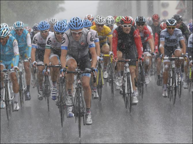 Cyclists play it safe in the rain The lead pack of cyclists rides in pouring rain Thursday during the sixth stage of the Tour de France.