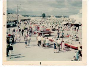 Bishop rides on the midway at Raceway Park in this 1969 photo.