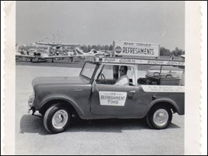 This 1961 International Harvester Scout carried a portable soda unit and popcorn for sale.