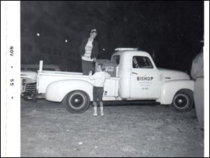 Bottle pop service from a 1948 Chevrolet pickup, in this 1955 Bishop family photo.