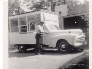 R.W. Bishop works on his first truck that he bought with the profits of selling popcorn outside Swayne Field. It was built on a 1948 Ford Woody station wagon chassis in 1954.
