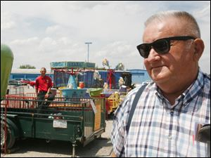 R.W. Bishop, seen here in this 2008 file photo with some of the carnival rides he built, retired in 1999 as general foreman for the City of Toledo Division of Streets, Bridges and Harbor.