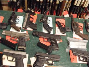 Guns in the property room of the Toledo Police Department that have been confiscated over the July 4th weekend.