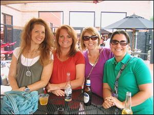 From left, Tracy Dippman, Trixie Stechschulte, Tonya Helvoigt, and Katie Perkins at the Hospice of Northwest Ohio 30th anniversary beach party.