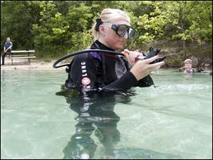 John's sister Ashley Harris prepares for her first open water dive as father Rod Harris watches from shore.