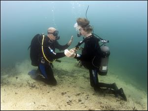 Instructor Jeff Davis  helps get John Harris under control during his first open water dive at White Star Park.