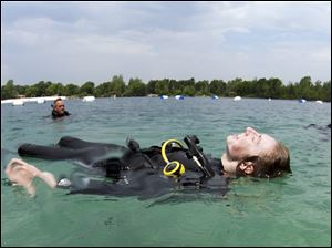 John Harris basks in the warm sun after completing his first open water dive at White Star Park in Gibsonburg.