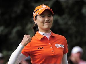 So Yeon Ryu reacts after sinking a birdie putt on the 18th hole to force a playoff. She then won the three-hole playoff over Hee Kyung Seo.