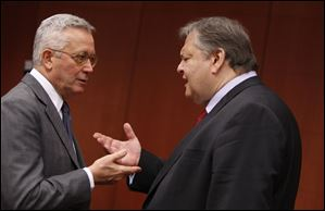 Italian Finance Minister Giulio Tremonti, left, speaks with Greek Finance Minister Evangelos Venizelos in Brussels.