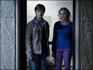 Evanna Lynch, right, is Harry Potter's friend and classmate Luna Lovegood.
