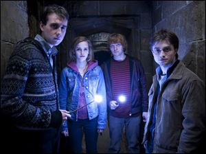 Matthew Lewis, from left as Neville Longbottom, Emma Watson as Hermione Granger, Rupert Grint as Ron Weasley and Daniel Radcliffe as Harry Potter.