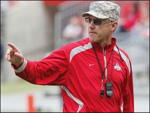 Then Ohio State football head coach Jim Tressel gives instructions during a spring game in Columbus in this April 23, 2011, file photo.