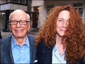Rupert Murdoch, left, chairman of News Corp., left, and Rebekah Brooks, then chief executive of News International, leave his residence in central London earlier this month.