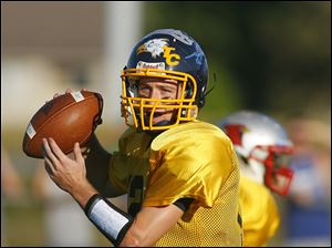 Gold Squad quarterback Nick Rightnowar (12) looks to pass during the second quarter.
