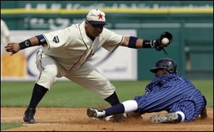 Chicago White Sox runner Juan Pierre, right, safely steals second under the tag of Detroit Tigers second baseman Carlos Guillen Saturday.