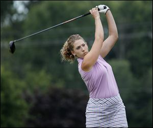 Helene Beat focuses on the ball after teeing off on No. 13 at Valleywood Golf Club in Swanton en route to winning the Toledo Women's District Golf Association title.