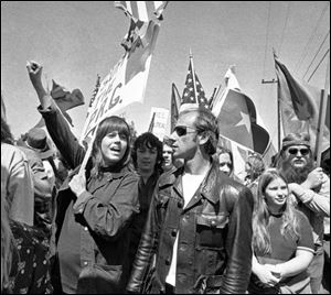 In April 2, 1973, actress Jane Fondajoins a group of anti-war demonstrators on a march toward the Western White House to protest the visit of South Vietnam's President Nguyen Van Thieu in San Clemente, Calif.