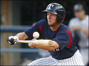 Toledo Mud Hens player Clete Thomas bunts safely to first in the fourth inning against Scranton/Wilkes-Barre.