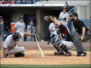 Toledo Mud Hens catcher Max St. Pierre catches the ball as Scranton/Wilkes-Barre Yankees player Kevin Russo dives out of the way of the pitch during the fifth inning.